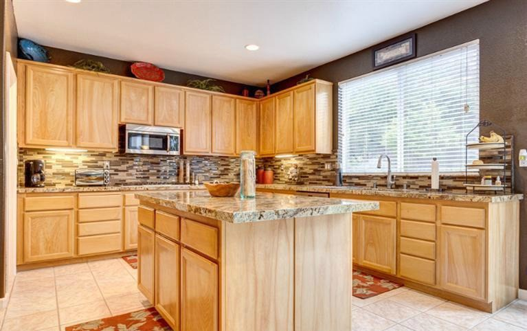 West Roseville home has gorgeous countertops and backsplash via Kaye Swain California real estate agent
