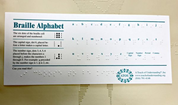 Roseville Seniors Real Estate Agent Kaye Swain sharing A Touch of Understanding Braille Alphabet Card
