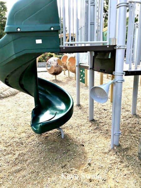 Baby Boomer REALTOR Kaye Swain and grandbaby enjoyed slide at Olympus Park Roseville