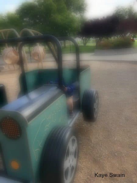 Grandbaby having fun driving a Jurassic Park style jeep at Olympus Park La Croix and Olympus Roseville California